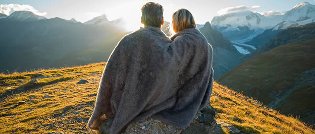 Couples enjoying sunset on mountain