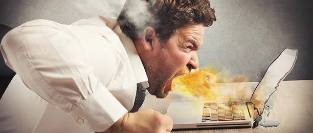 Internet addicted man yelling at laptop