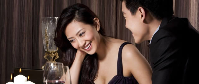 Happy Asian woman at dinner