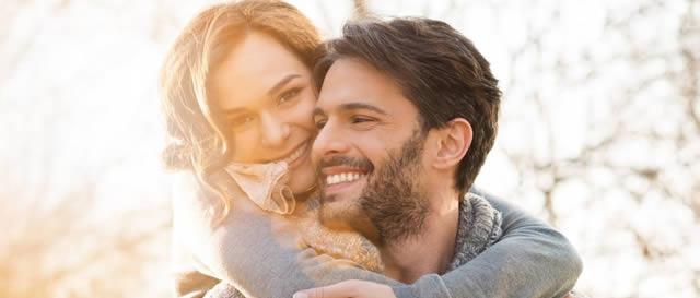 Happy Couples in sunglight hug